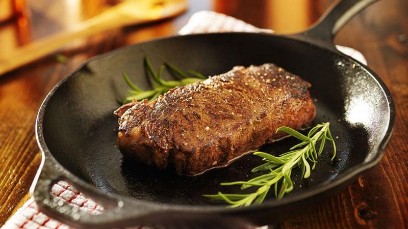 strip steak in iron skillet