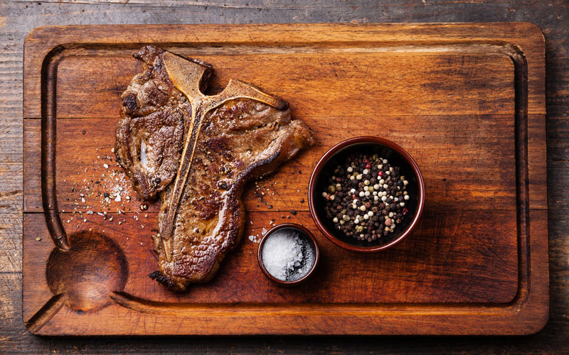 Grilled T-Bone Steak resting on cutting board