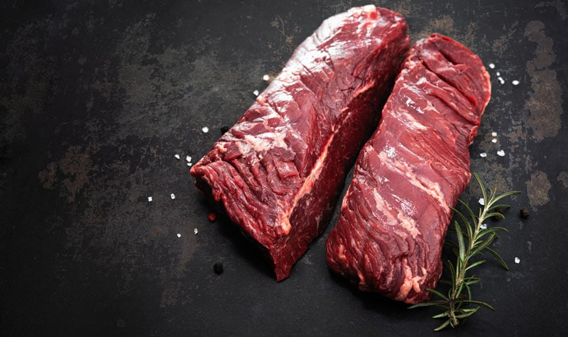 Two raw hanger steaks, also known as butcher's steak or hanging