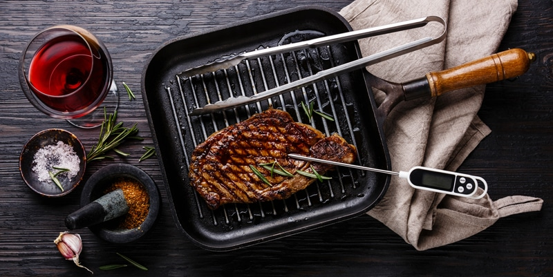 Grilled Steak on pan and meat thermometer